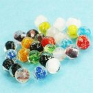 Bead mix, lampworked glass, multicolored, glow-in-the-dark, 10mm irregular round. Sold per pkg of 10.