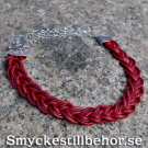 Braided necklace with cords and large ends