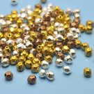 Mixed metal beads, 3x3.5mm, faceted, 10g - approx. 95 beads