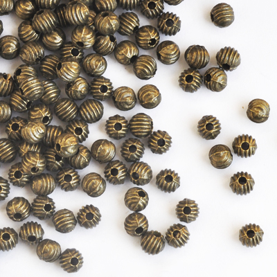 Metal beads, 4mm round, corrugated, antique bronze-coloured, 10g - approx. 50pcs
